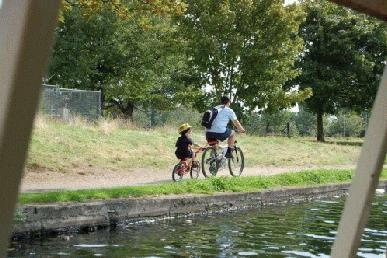 Cyclist and son on towpath