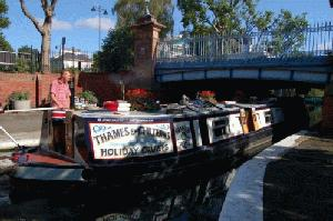 A narrowboat traversing the Regents Canal
